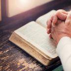 Praying with Bible - shutterstock