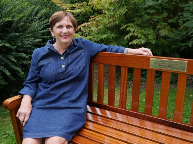Denise-Hughes-sitting-on-bench-dedicated-to-her-for-long-servcie-to-the-Diocese-1